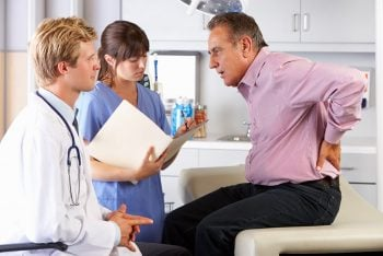 man visiting doctor for back pain